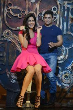 Dhoom 3's bombshell, Katrina Kaif and Maskhara Aamir Khan were clicked in an animated pose during the music launch
