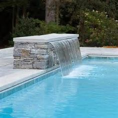Cascading waterfall into pool with bench underwater contemporary-pool . Cascading waterfall in Backyard Pool Landscaping, Small Backyard Pools, Swimming Pools Backyard, Ponds Backyard, Swimming Pool Designs, Outdoor Pool, Backyard Waterfalls, Garden Ponds, Koi Ponds