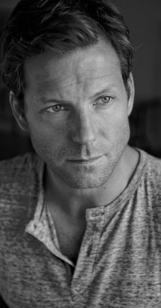 Jamie Bamber, Actor: Battlestar Galactica. Jamie Bamber was born on April 3, 1973 in Hammersmith, London, England as Jamie St John Bamber Griffith. He is an actor, known for Battlestar Galactica (2004), John Doe: Vigilante (2014) and Law & Order: UK (2009). He has been married to Kerry Norton since September 20, 2003. They have three children.