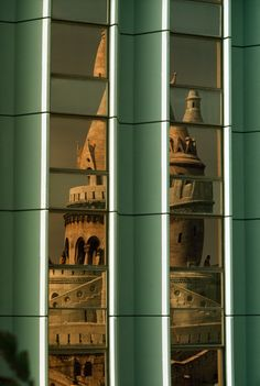 The Fishermens Bastion is reflected in the windows of a modern hotel in Budapest, Hungary - photograph from the National Geographic 1977
