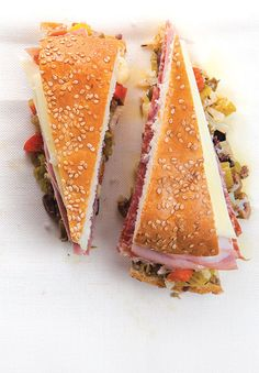 Muffuletta At Central Grocery in New Orleans, they use their famous olive salad to dress deli meats and cheeses in an irresistible sandwich. It's best eaten the day after it's made, to allow the salad to marinate the other ingredients. Muffuletta Recipe, Muffuletta Sandwich, Tostadas, Tacos, Paninis, Beignets, Cajun Recipes, Cooking Recipes, Easy Recipes