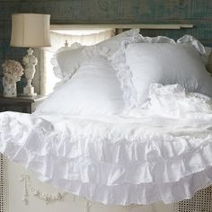 Petticoat White Bedding Collection features a lavish and lovely white linen with tiered layers of delicate lace trim inspired by a vintage Flamenco dress from Rachel's own closet