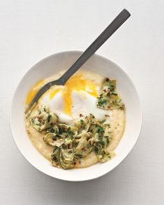 Poached Eggs, Polenta, and Marinated Artichokes -- Polenta's hearty whole grain makes an ideal foil for artichoke hearts in a quick marinade of spicy vinaigrette. The yolks play the role of silky sauce. Marinated Artichoke Recipe, Artichoke Recipes, Polenta, Healthy Egg Recipes, Healthy Food, Menu, Poached Eggs, The Best, Breakfast Recipes