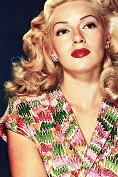Lana Turner movie star vintage fashion icon pin up girl colorful print dress green pink casual 40s portrait