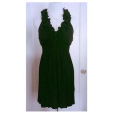{forever 21} black ruffled halter dress Flirty and fun black ruffled halter dress from forever 21. Has built in cups so no need to wear a bra! Ruched at the waist for the perfect fit. Gently worn. Forever 21 Dresses