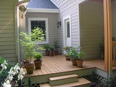 A small deck off the kitchen. Notice that the downspout on the right has been painted to blend with the wood and disappear.