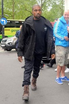 Kanye West wearing Yeezy 950 Boots in Chocolate and Yeezy Season 1 Hooded Jacket