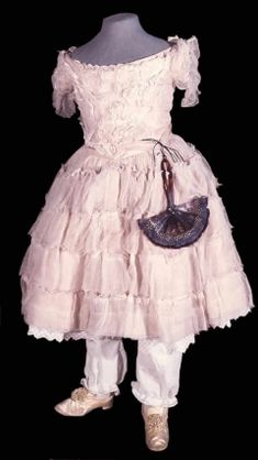 Pink taffeta child's dress covered with coarse stiff pink muslin, with short sleeves and low neck. Belgium c. 1856