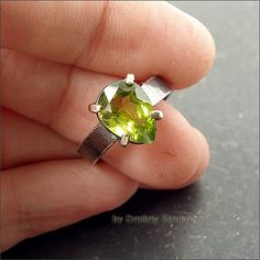 Laconic ring with peridot, is made of silver, decorated with brass, patinated metal and partially polished. Stone beautiful colors, bright (weight of 2.5 carats).   On 17,5-17,7 size, the width of the shank 4 mm, weight 3,6 g