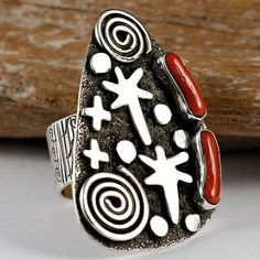 Navajo silversmith Alex Sanchez's distinctive overlay work is inspired by actual prehistoric petroglyph designs found in ancient ruins throughout the southwest. One of the most famous petroglyph displays can be found on rock inside the Canyonlands National Park in southern Utah. The art depicts the presence of  animals in the area, also human's, the sun, moon, stars, sacred four winds, and energy patterns in the southwest.    This fascinating ring features spirits, stars, & energy patterns.