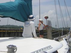 Alfredo and Alicia (world adventurers and line handlers on this transit) with our pilot. Getting ready to transit the locks, Panama Canal, trimaran Ladyhawke. See http://www.amazon.com/Everyone-Said-Should-Write-Another/dp/1470072777 to read stories re. our adventures, including Alfredo and Alicia!