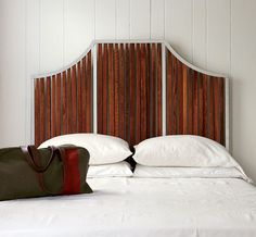 "Photo Credit: Brie Williams. Rustic yet refined, this headboard is made of handcrafted steel and reclaimed tobacco drying sticks, a tribute to the firm's North Carolina heritage ($1,050; ""http://vancollier.com)."