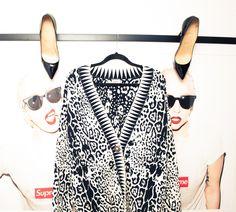 Leopard print sweater & Louboutin pumps.