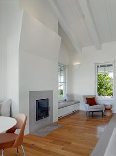 Simple clean fireplace with hearth flush to wood floor - Min|Day Sonoma County farmhouse
