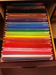 Awesome construction paper organization idea...hanging file folders.