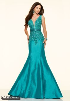 Available in Teal and Red