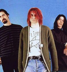 This is a fantastic picture, but I especially love Dave Grohl's pose and facial expression!!