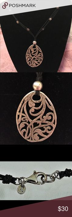 Silpada N1805 .925 Filagree cord pendant. Show piece silpada.  .925 Sterling.  Sterling .925 Sterling Filagree pendant on cord necklace with sterling bead accents and clasp.  NWOT.  BOUGHT AS A SHOWPIECE.  Mint condition. Silpada Jewelry Necklaces