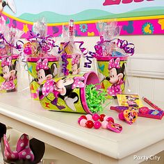 Minnie Mouse Party Ideas: Favors - Fill reusable Minnie Mouse Party cups with assorted favors
