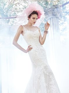 Maggie Sottero - noelle, Elegant romance is found in this soft fit and flare wedding dress, constructed of delicate tulle and lace. Finished with illusion neckline, dramatic illusion back, and pearl buttons over zipper closure. Fit And Flare Wedding Dress, Perfect Wedding Dress, Elegant Wedding, Wedding Dresses Photos, Wedding Dress Styles, Dress Wedding, Bridal Dresses Online, Bridal Gowns, Sottero And Midgley Wedding Dresses