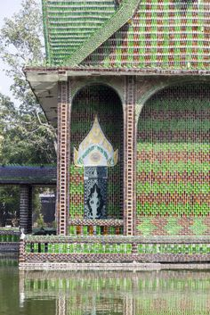 """In 1984, a group of monks were peeved by litter in Sisaket, Thailand, so they asked locals to bring them recycled beer bottles to create a temple — and it worked. According to Atlas Obscura, every inch of the """"Temple of a Million Bottles"""" is made of recycled bottles  — from the crematorium to the sleeping areas and toilets. This is way more than """"99 Bottles of Beer On the Wall."""""""