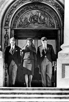 11/25/63 - Jackie, Bobby, and Teddy leave the Capitol, to wait below for JFK's casket to be carried down for it's trip to the White House and cathedral.