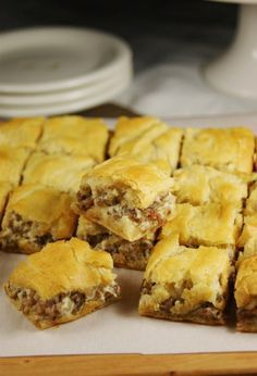 Breakfast bites. Sausage, crescent rolls and cream cheese. Might add scrambled eggs.
