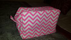 Brand New Pink and White Chevron Large Makeup Bag - Approximately 9 inches long x 6 inches tall - Was bought from an online store and has never been used - *Note: The flash makes it look pink and gray but it is pink and white