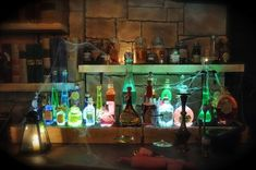 Magic potion display rack. Bottles and vials sit atop a template with holes that let fluorescent light shine through.