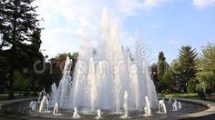 Fountain in the park near trees.