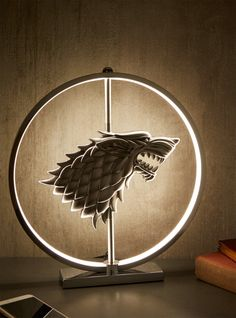 Bring a little bit of Winterfell to your own personal castle with this House Stark LED table lamp. This lamp features the Stark direwolf and has 90 LEDs. Game Of Thrones Bedroom, Game Of Thrones Decor, Game Of Thrones Tyrion, Game Of Thrones Gifts, Game Of Thrones Fans, Game Of Thrones Merchandise, Photo Deco, Dire Wolf, House Stark