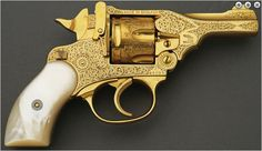 19th Century Late.  Gold plated and engraved Webley and Scott double action revolver with pearl grips.