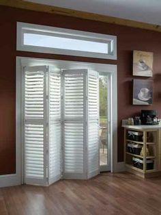 Use sliding closet door/room divider for sliding glass door- no more venitian blinds!