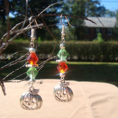 Halloween Jack-o-Lantern earrings with green and orange crystals. $7.00, via Etsy.