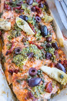 Mediterranean Salmon in Parchment Paper with sun-dried tomatoes kalamata olives dill capers and artichoke hearts. This easy dinner recipe is paleo keto and packed with flavor! Fish Recipes, Seafood Recipes, Dinner Recipes, Cooking Recipes, Healthy Recipes, Dairy Free Salmon Recipes, Fancy Recipes, Bacon Recipes, Keto Recipes