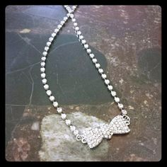 Bow necklace This piece is super cute and so different cause it closes with a stretch band! Jewelry Necklaces