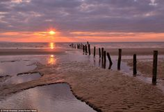 Detailed: This photo captures the stillness of Berrow Beach, Somerset, early in the morning