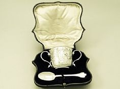 A fine antique George V English sterling silver christening porringer and spoon; part of our silverware collection