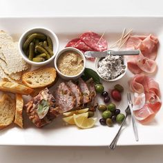 Artfully arrange pates, Italian meats, olives, pickles, spicy mustard, and toasted baguette slices for a party tray that's pleasing to both the eye and the appetite.