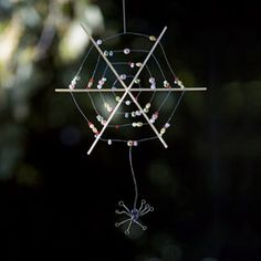 Beaded Spiderweb activity for Emma to decorate the garden  3 (12-inch) bamboo skewers  Ruler  24-gauge jewelry wire (available at craft stores)  Glass beads