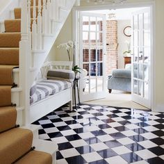 This chequerboard floor is so shiny we think it might have been used in an advert for flash! The sofa under the stairs is a clever use of space too