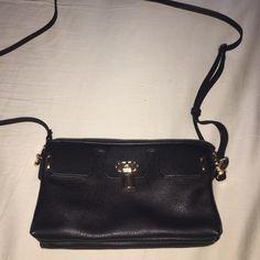 Cute Mini Black Purse Never used mini purse .. Has long strap to carry.. Gold hardware.. Multiple pockets.. Bags Mini Bags
