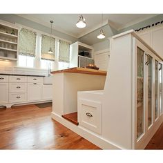 maybe replace the railing with a bench seat with these cabinet doors on the other side in the den?!