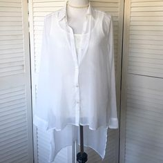 Hollister sheer off-white hi-low blouse Feminine but not precious! Delicate sheer winter white poly chiffon. Button front, collar, long sleeves with button cuffs. Shorter in front, longer in back. A gorgeous layering piece. Juniors size L. NWOT; never worn. Hollister Tops Blouses