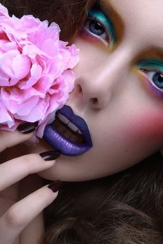 tulip inspired look, colorful teal rainbow eyes with purple lips and lightly pink cheeks.