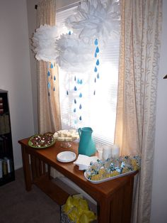 April showers! Raining Clouds for Baby Shower, could do raindrops of  many colors @Sherri Bornhoft