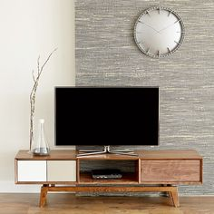 Get inspired by the Modern Art vibe of this media stand. Chic gray doors are a sleek complement to the natural wood-grain drawers.