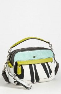 This cute Diane von Furstenberg Milo cross body summer bag is a must for summer! The wild animal print and the bright green accents are fun and stylish for everyday!    http://stealthatdress.com/fab-extras-diane-von-furstenberg-bold-bag/#