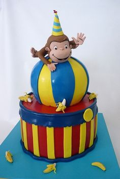 "my next cake to make for a 6 year little boy.  using again the 3D sports ball pans   3 layers of 8""x2"" cake  and fondant geroge balanced on top"