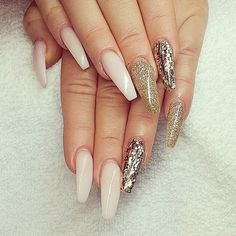 Shades of gold glitter and nude long coffin nails